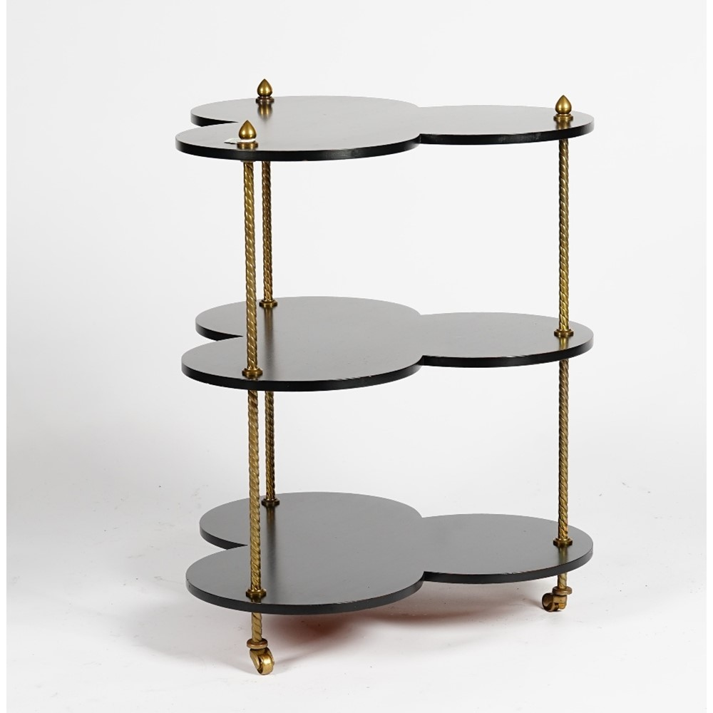 An ebonised and gilt metal clover-leaf shape three tier table, 56cm wide x 69cm high. Image