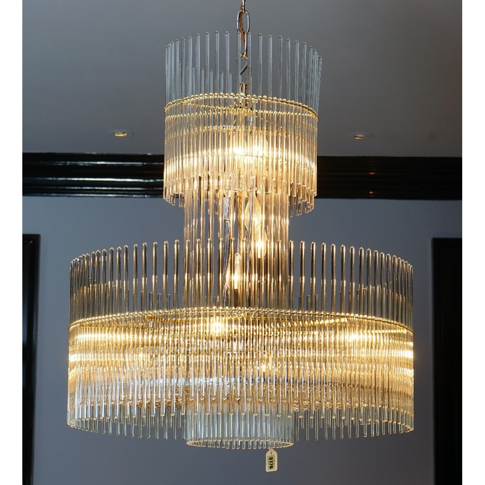 A contemporary glass and gilt metal frame chandelier, hung with tubular drops, 80cm drop. Image
