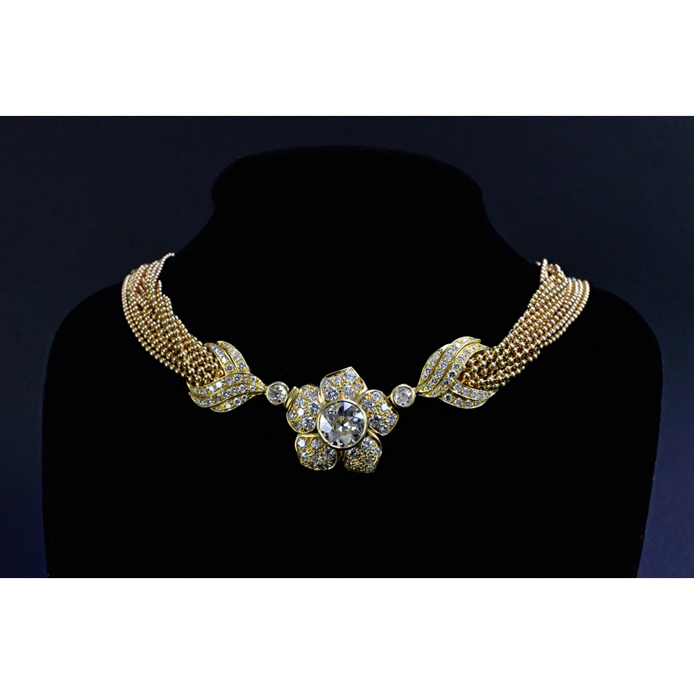 A gold and diamond floral necklace, the... Image