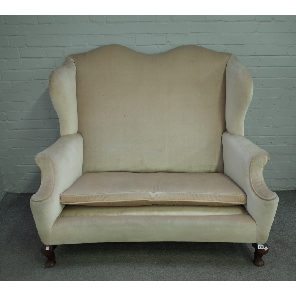 An early 18th century style wingback sofa on squat mahogany cabriole supports Image