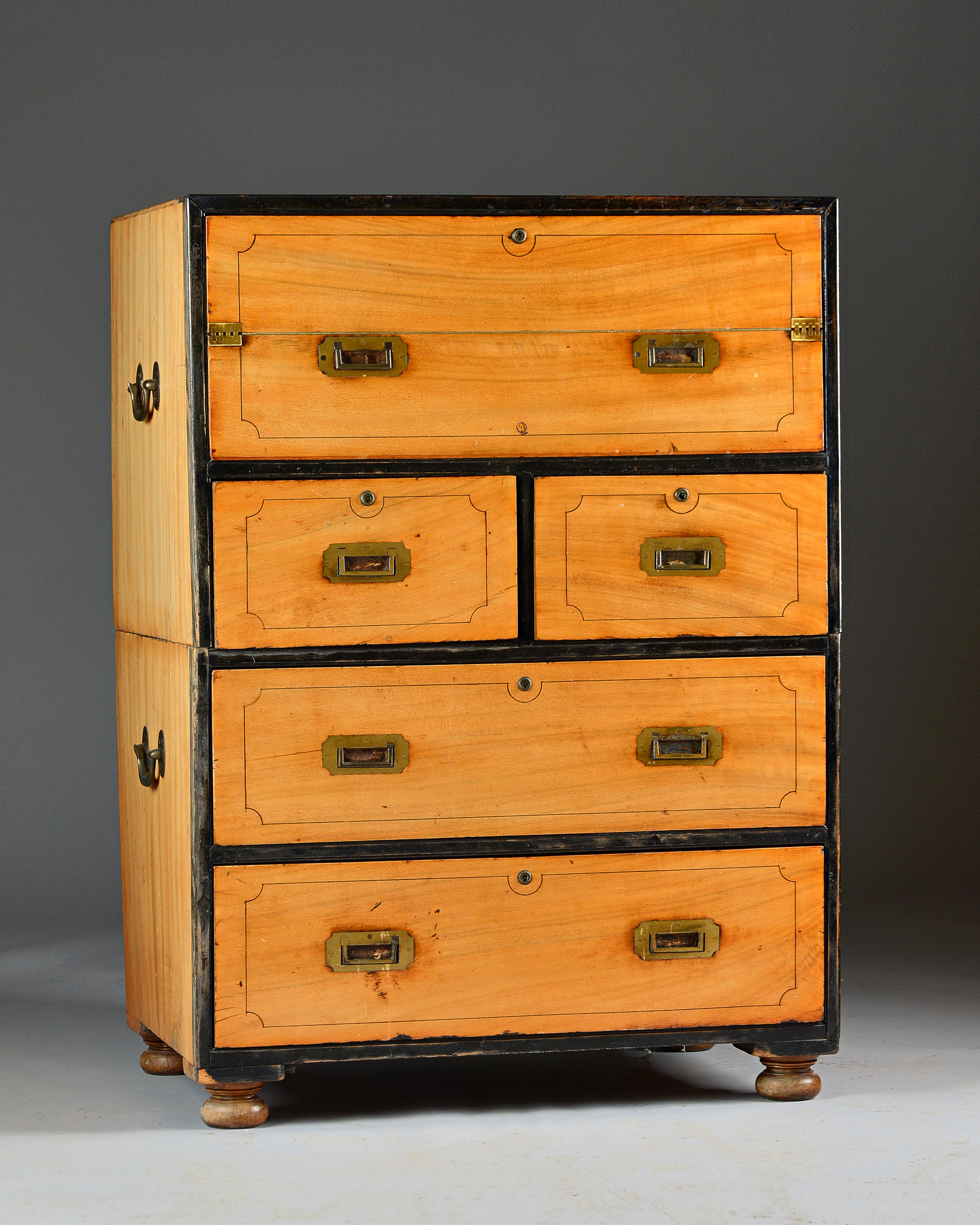 A 19th century Anglo-Indian ebony bound camphor wood two part campaign chest Image