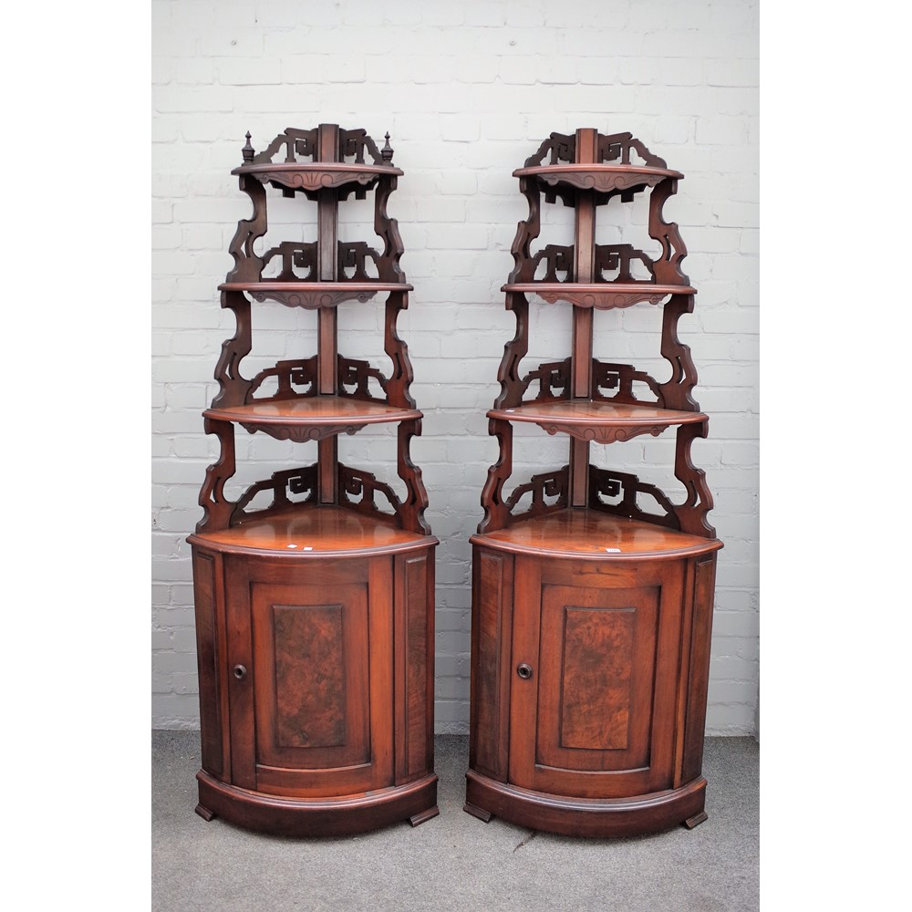 A pair of French walnut corner display shelves/cupboards Image
