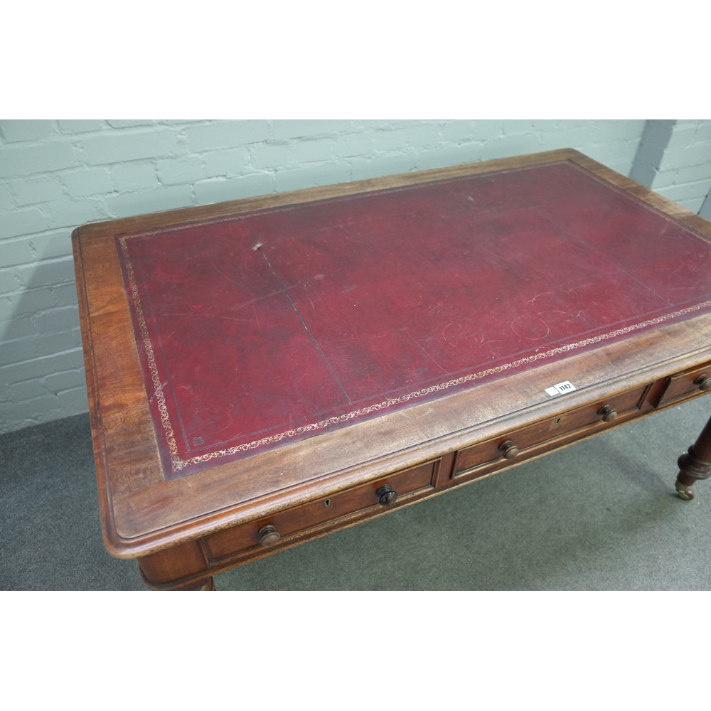A William IV mahogany centre library table with six opposing frieze drawers on turned supports Image