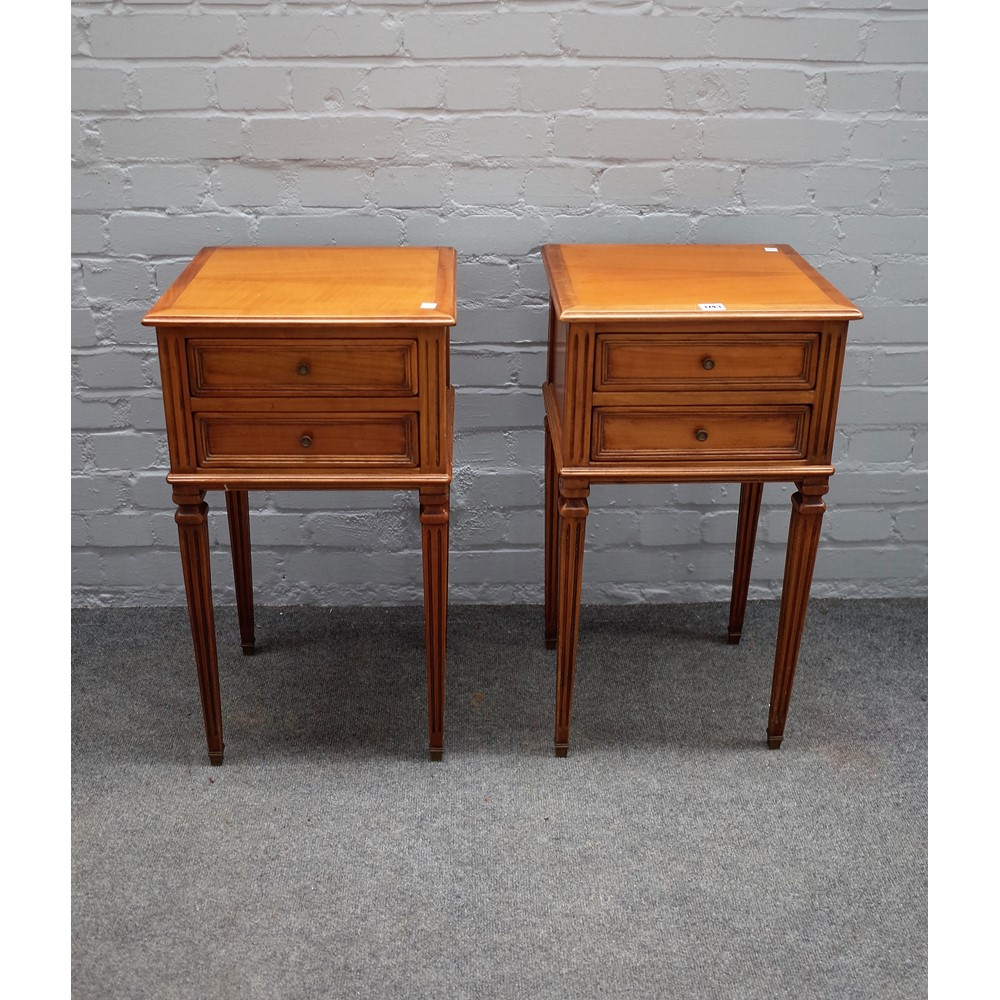 A pair of Louis XVI style fruitwood two drawer bedside tables on tapering square supports 39cm wide Image