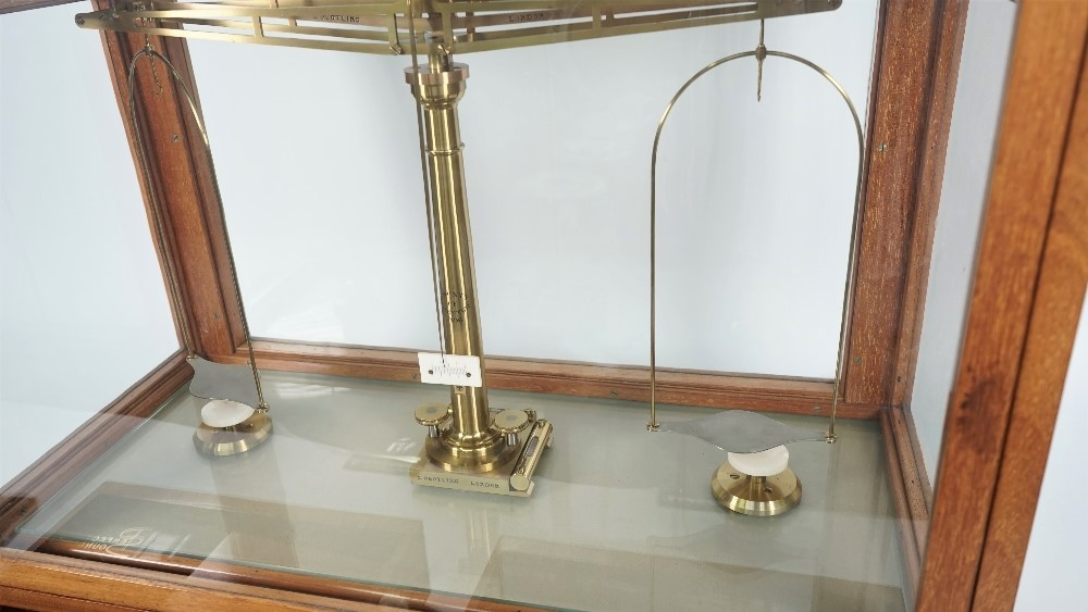 A mahogany cased brass and ivory mounted precision beam scale by L Oertling London, engraved... Image