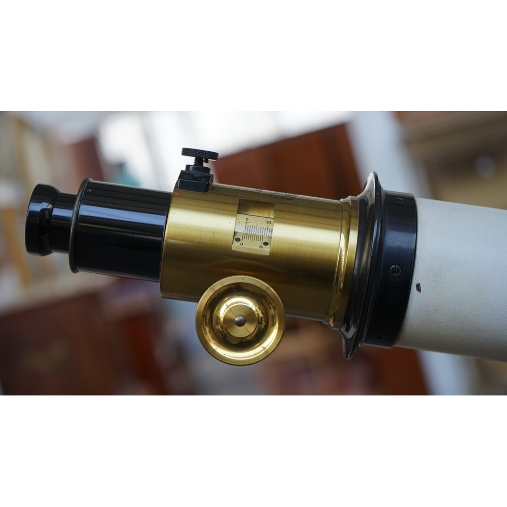 A mid-20th century Carl Zeiss Jena telescope with tripod and accessories in a fitted wooden case,... Image