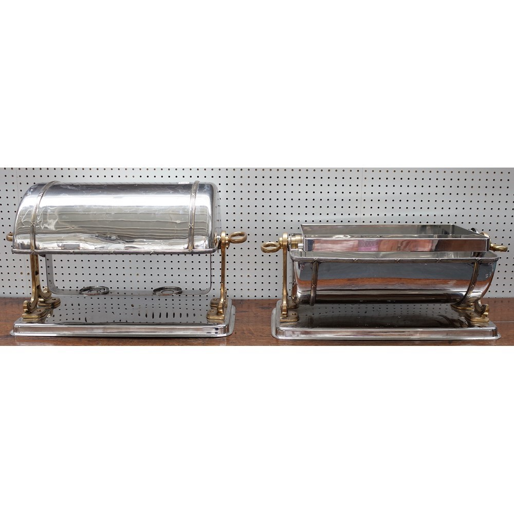 A pair of silver plated food warmers, 20th century, of domed form on a brass frame, with twin... Image