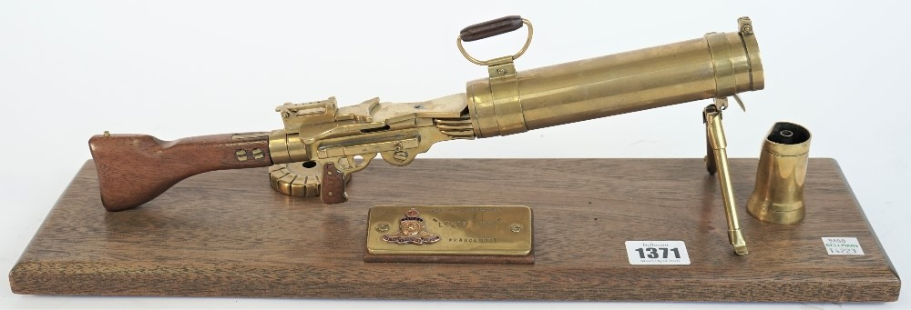 A brass model of WW I Lewis machine gun, 20th century, with brass plaque to the mahogany base,... Image