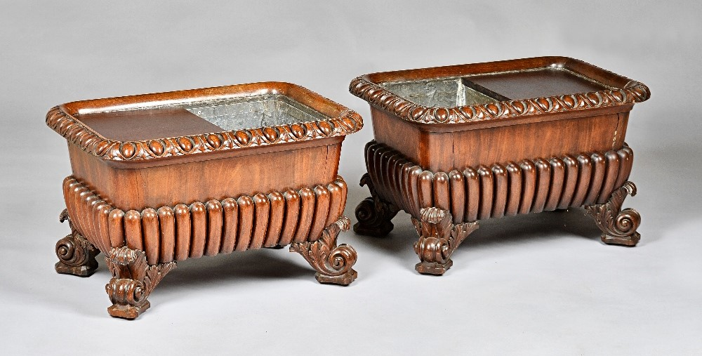 A pair of George IV mahogany wine coolers, each with egg and dart rounded rectangular tops, over... Image