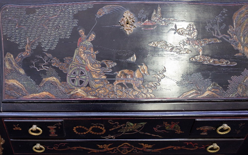 A mid-20th century black lacquer, gilt metal mounted bureau, decorated with Eastern figures on... Image