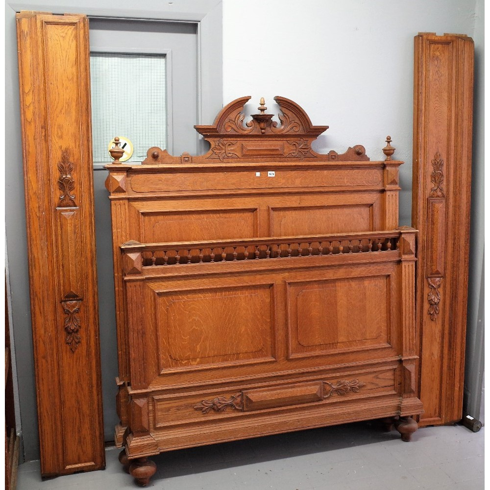 A 19th century French oak double bed, with double panel head and foot board, 142cm wide x 167cm... Image