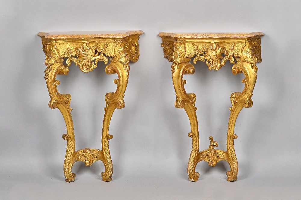 A pair of late 18th century French consoles, each with serpentine marble top, over a floral... Image