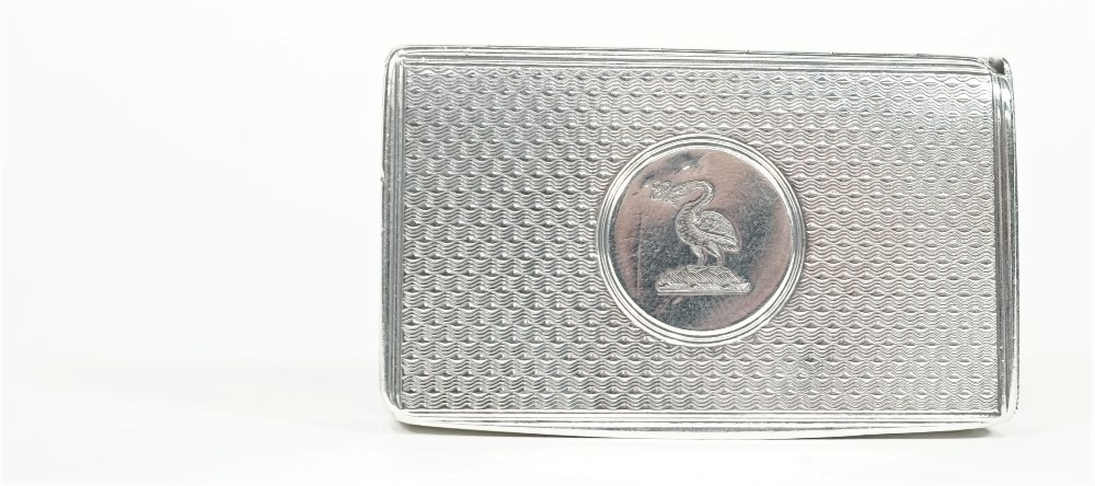 A Victorian silver vesta case, of rectangular form, having all over engine turned decoration, the... Image