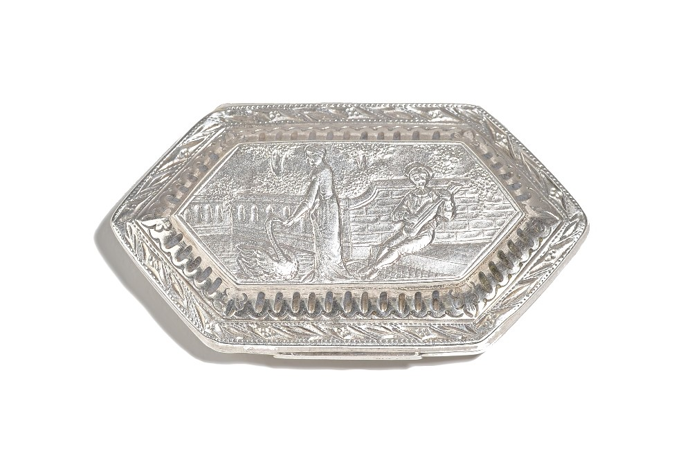 A George III silver box, of lozenge form, the cover embossed with a classical scene of a lady... Image