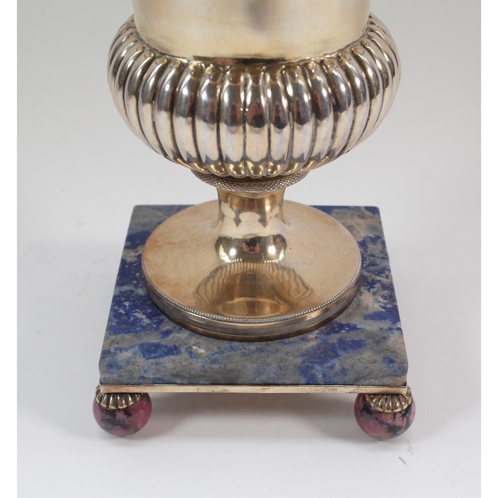 A French Empire silver gilt urn and cover, the body of bulbous form, with fluted decoration, the... Image