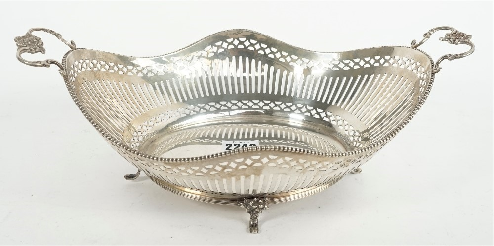 A Dutch twin handled fruit or cake basket, of shaped oval form, having pierced decoration within... Image