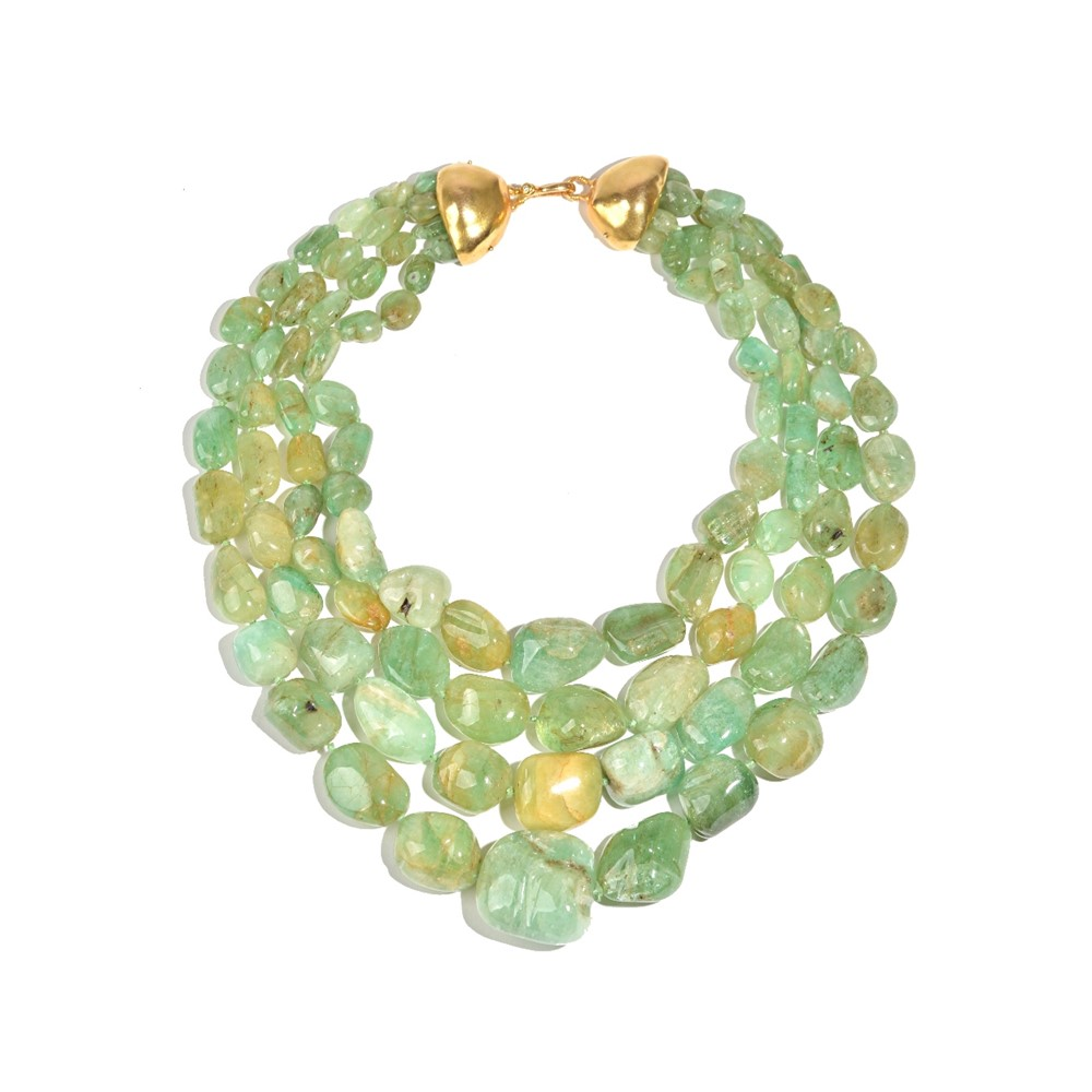 An Angela Pintaldi four row necklace of graduated varicoloured pale green hardstone beads, on a... Image