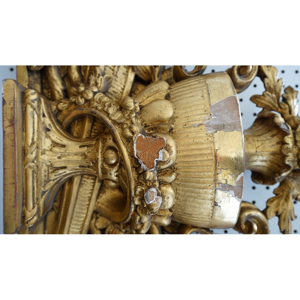 A giltwood and gesso door surmount, late 19th century, with central fluted urn over a quiver of... Image
