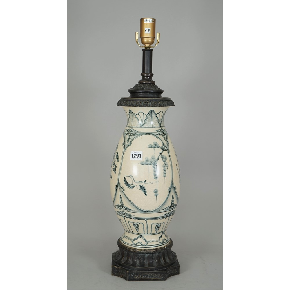 A modern pottery table lamp decorated in the Chinese taste, 50cm high, and an opaque glass... Image