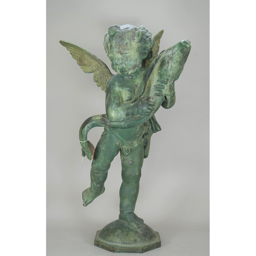 A verdigris patinated bronze fountain head, 20th century modelled as winged putto holding a... Image