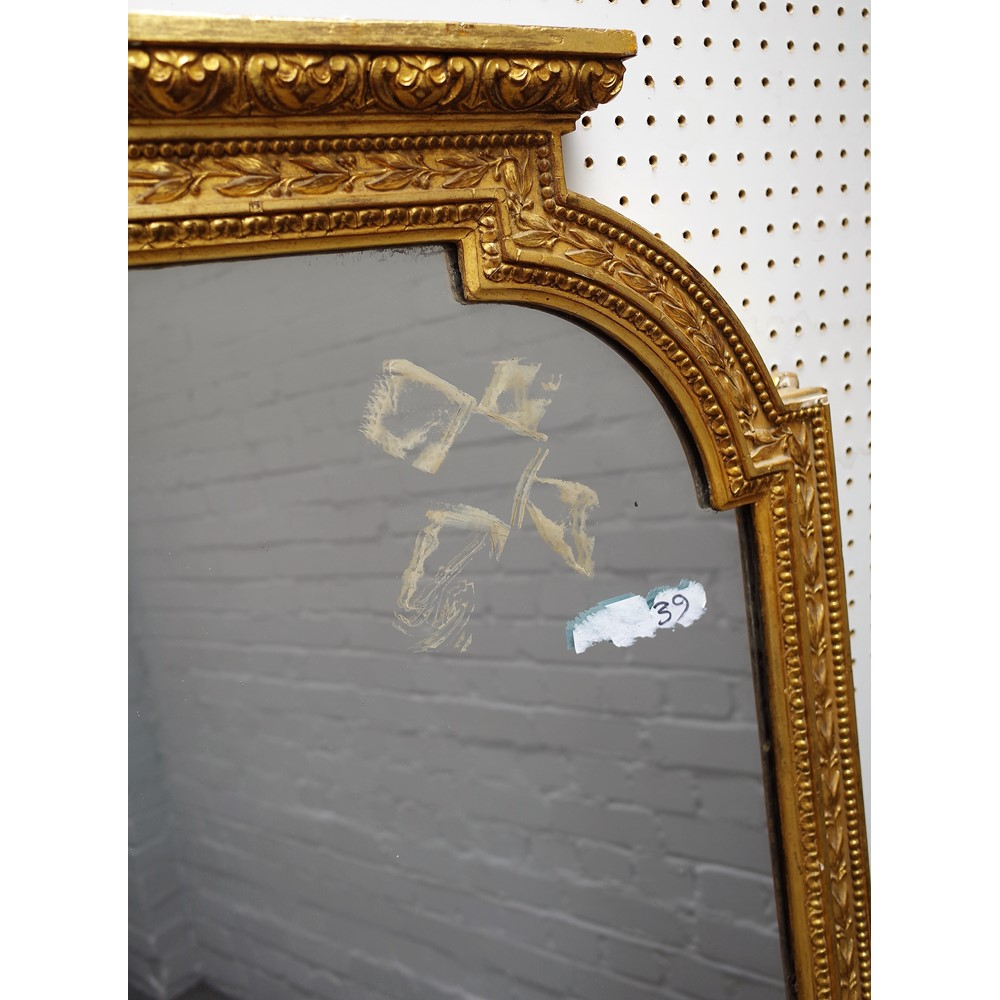A Victorian gilt framed arch top overmantel mirror with floral moulded frame, 127cm wide x 163cm... Image