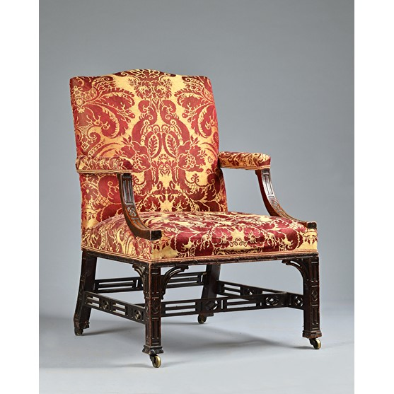 A George III mahogany Gainsborough chair, with blind fret decoration on square supports, 71cm... Image