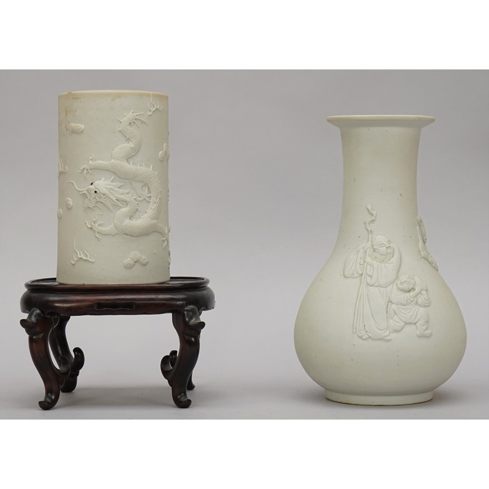 A Chinese white biscuit porcelain pear shaped vase, late 19th/20th century, moulded in relief... Image