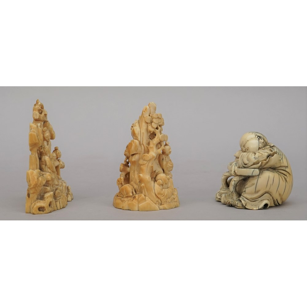 Two small Chinese ivory groups, 19th century, one carved as three figures around a table before... Image