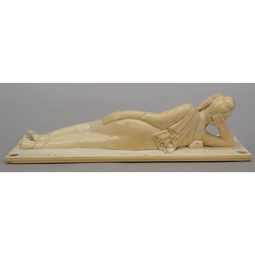 A Burmese ivory figure of Buddha, late 19th/early 20th century, carved in recumbent pose with her... Image