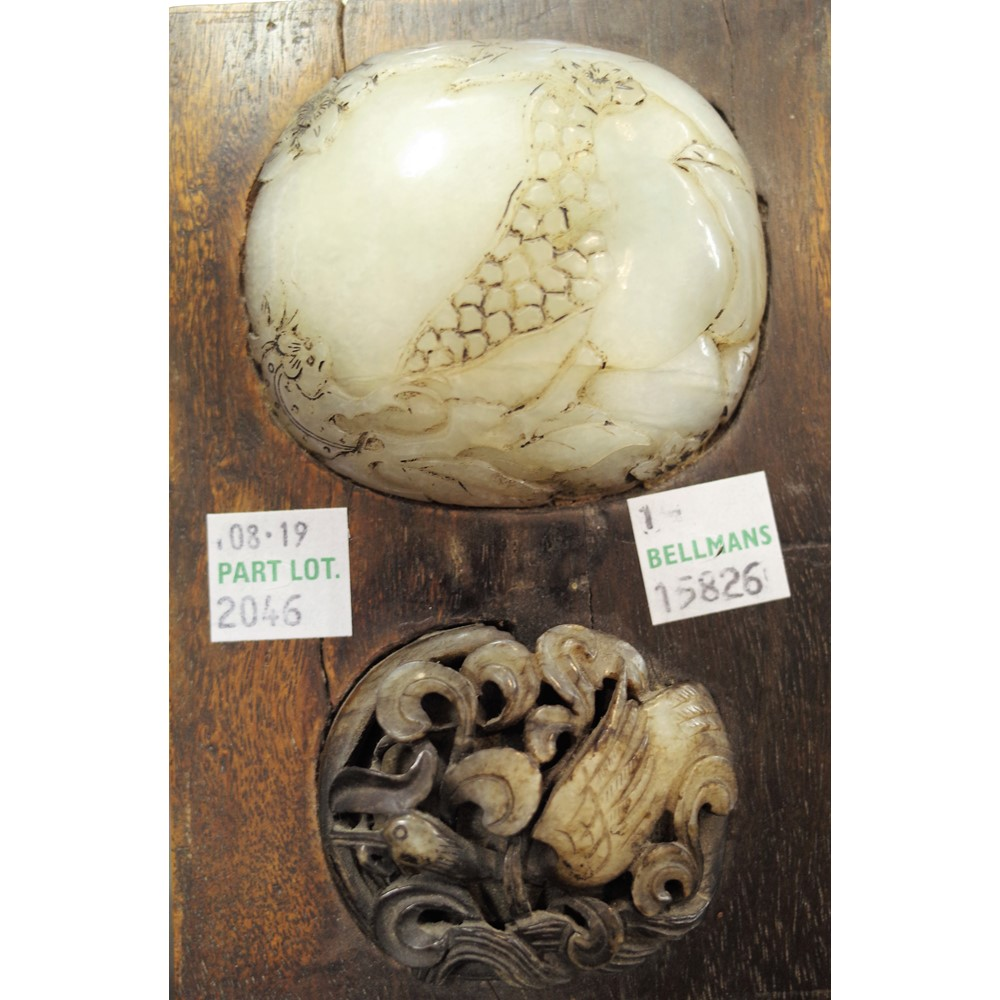 Two Ming style grey and white jade oval plaques, 17th century or later, one pierced and carved... Image