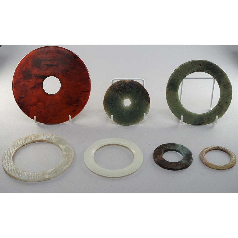 A group of seven Chinese jade bi discs and bangles, of various size and colour, 5.5cm. to 13.5cm.... Image