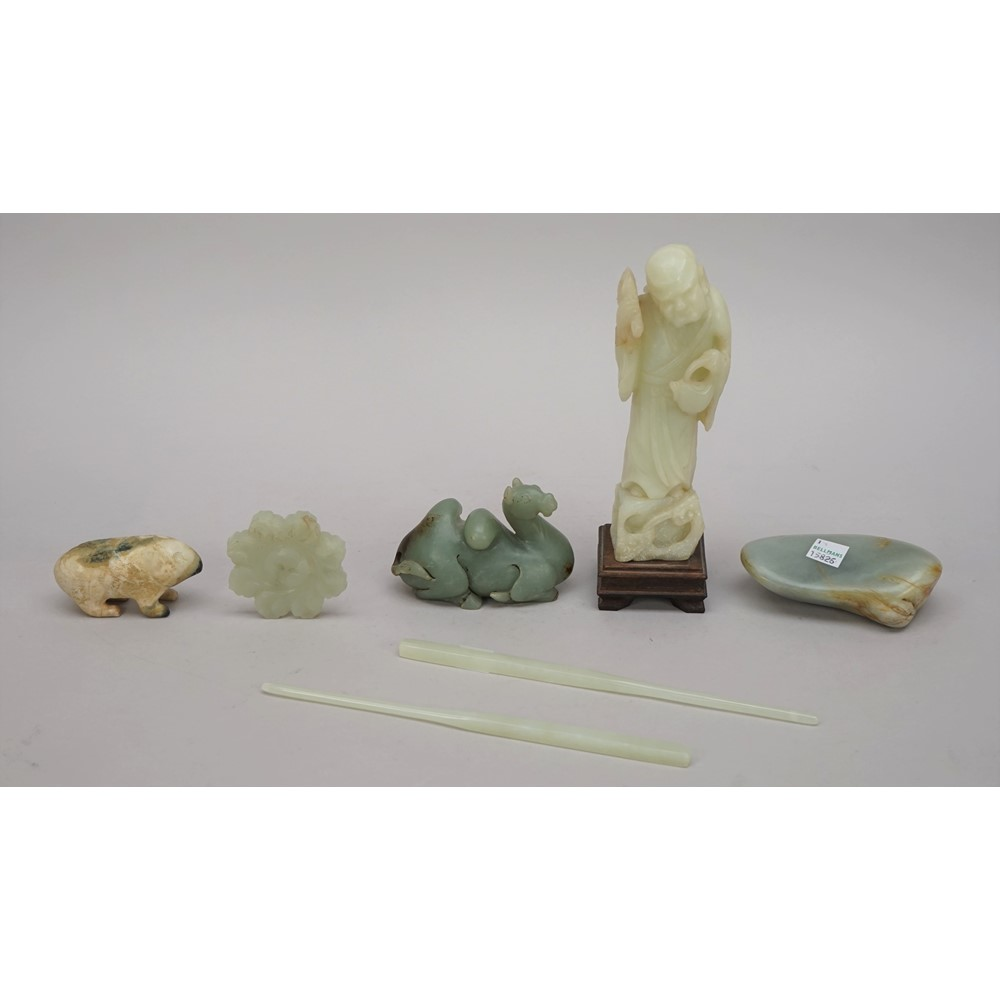 A group of Chinese jade and hardstone carvings, comprising; a pair of pale celadon jade... Image