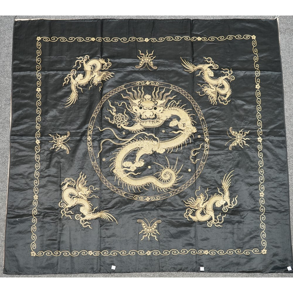 A Chinese black-ground embroidered tableloth, 20th century, worked in high relief in gilt wire... Image