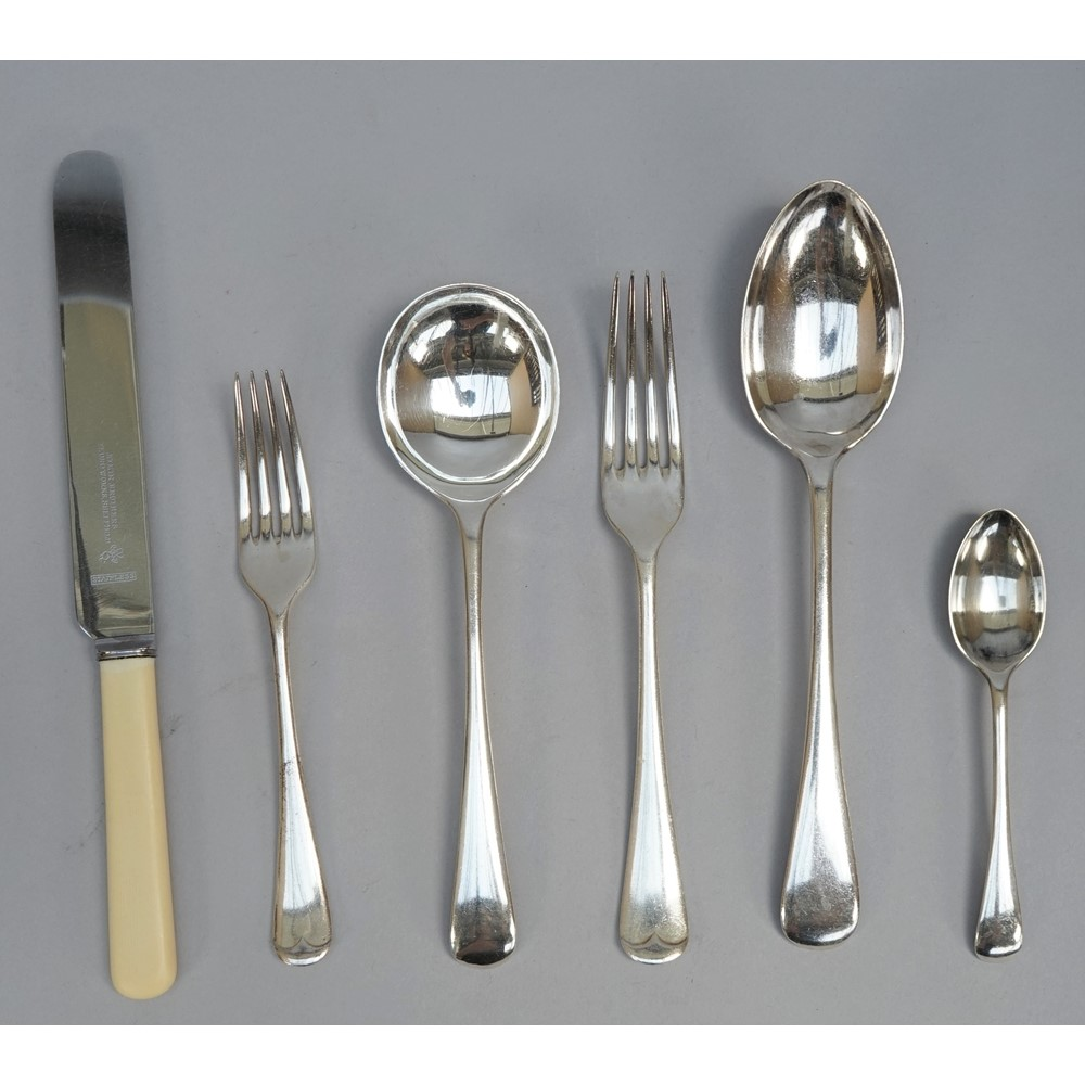 An Old English pattern canteen of plated table flatware, comprising; six soup spoons, six table... Image