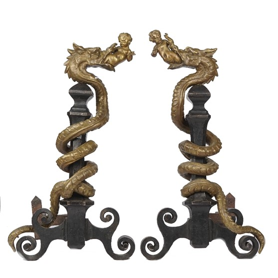 A pair of Italian bronze and cast iron fire dogs, early 19th century, each cast with a dragon... Image