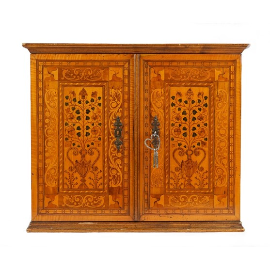 Augsburg early 17th century, an extensively marquetry inlaid table cabinet, the pair of doors... Image