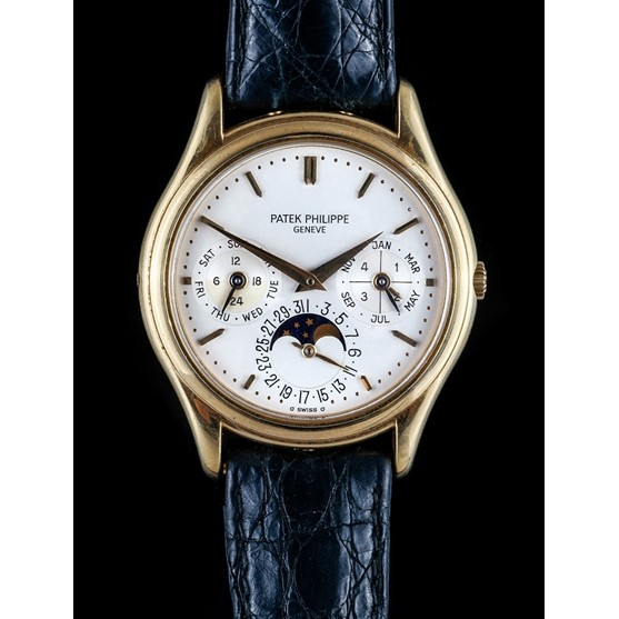 A Patek Philippe gold circular cased gentleman's calendar wristwatch, the jewelled automatic... Image