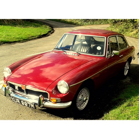 A 1974 MGBGT 1800cc, damask red with... Image