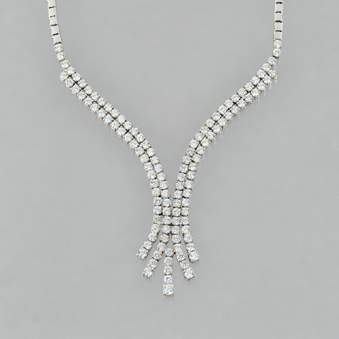 A white gold and diamond set necklace,... Image