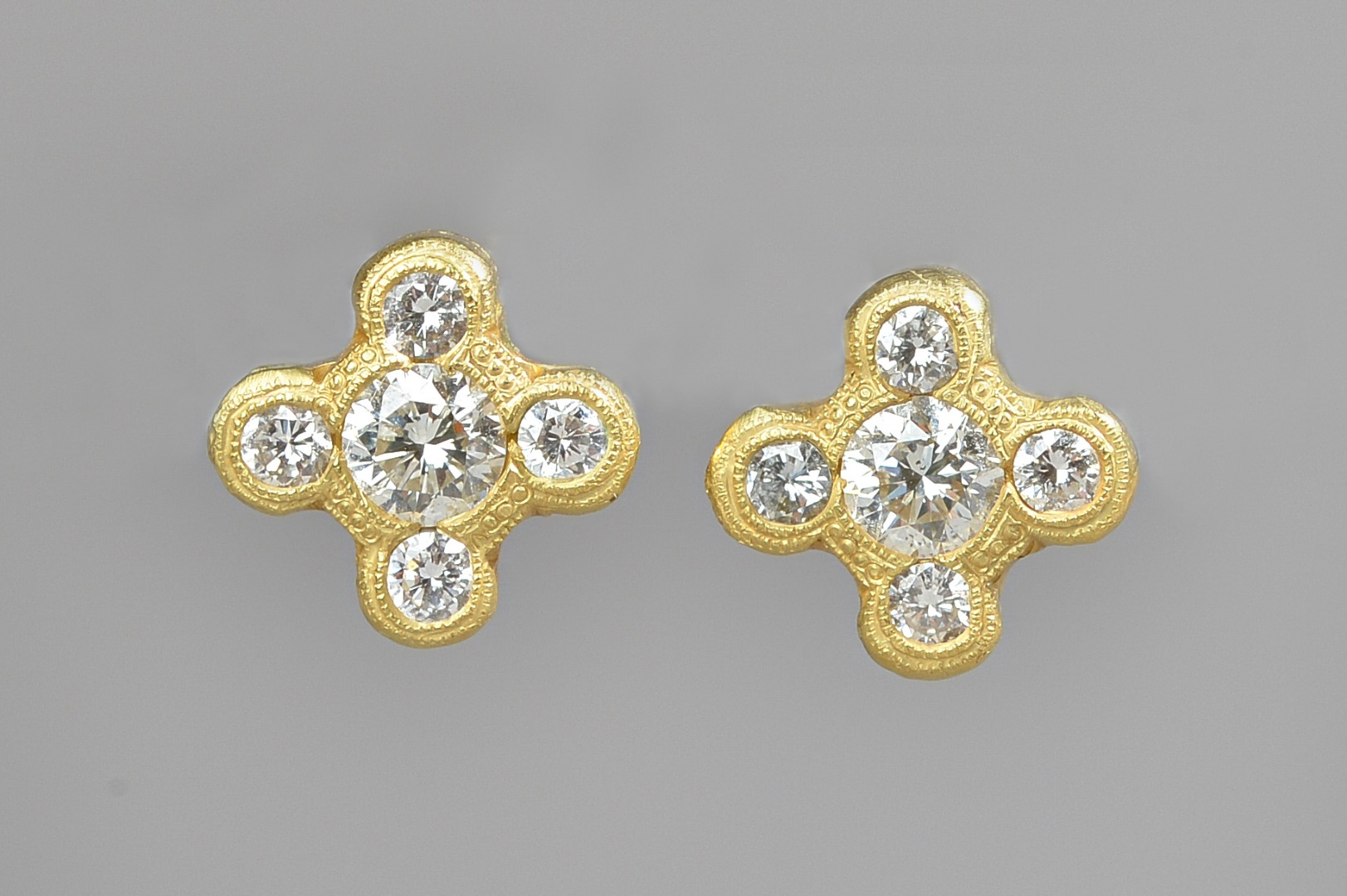 A pair of gold and diamond set five... Image