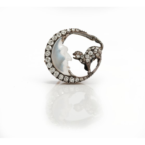 A late 19th/early 20th Century carved moonstone and diamond set man-in-the-moon and cat brooch of... Image