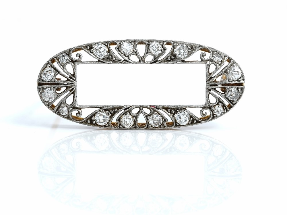A gold and diamond brooch, in an oval openwork design, with a rectangular centre, the pierced... Image