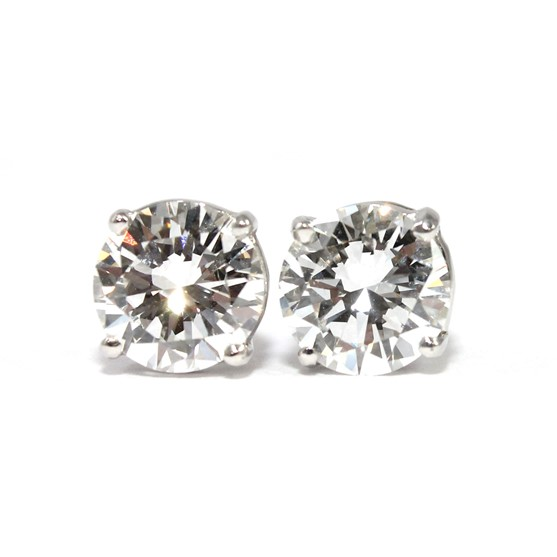 A pair of diamond set single stone... Image