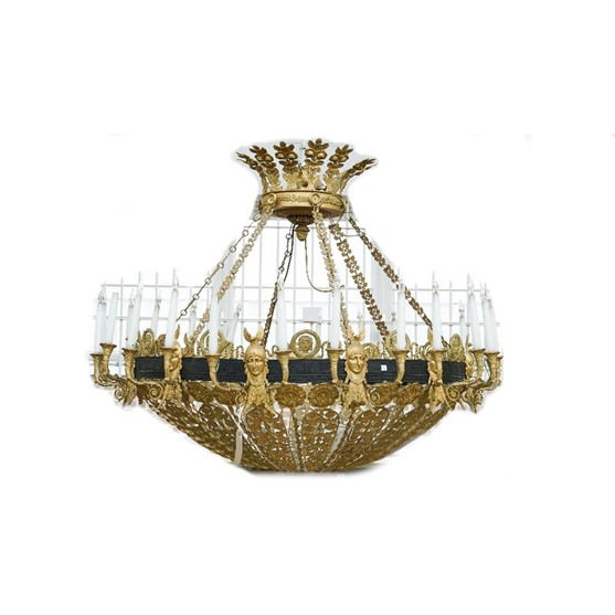 An ormolu and patinated bronze twenty four light chandelier of pierced dished form, 20th century,... Image