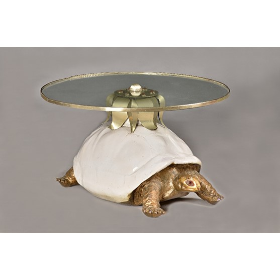 Anthony Redmile; a tortoise coffee table, the banded circular glass top on a resin shelled and... Image