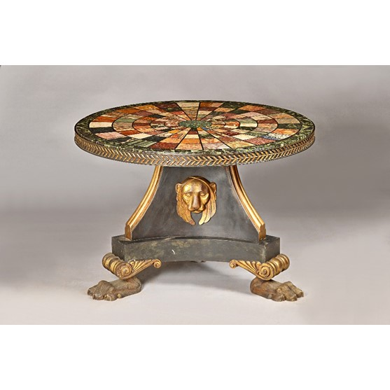 A Regency design centre table, the specimen marble circular top in a floral cast metal band over... Image