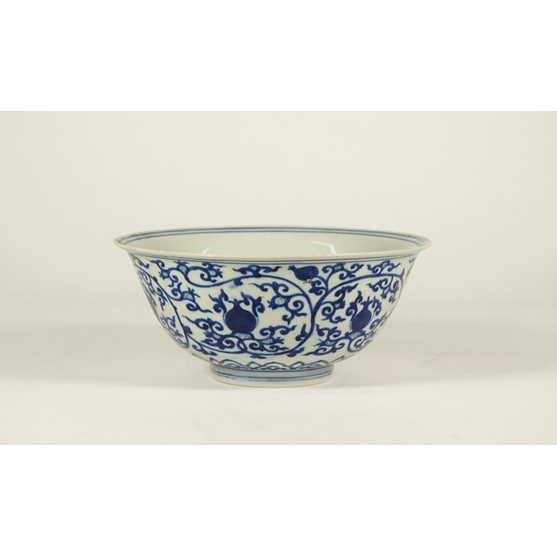 A Chinese porcelain blue and white bowl, Wanli six character mark but later, painted with fruit... Image