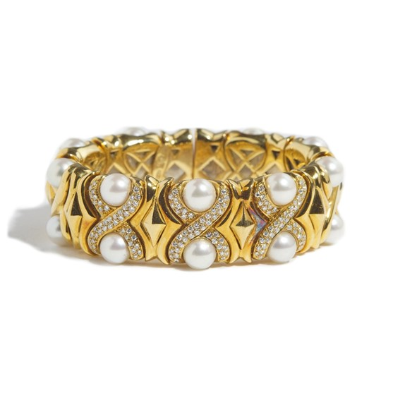 An Italian gold, diamond set and cultured pearl sprung bangle, the front designed as curved 'X'... Image