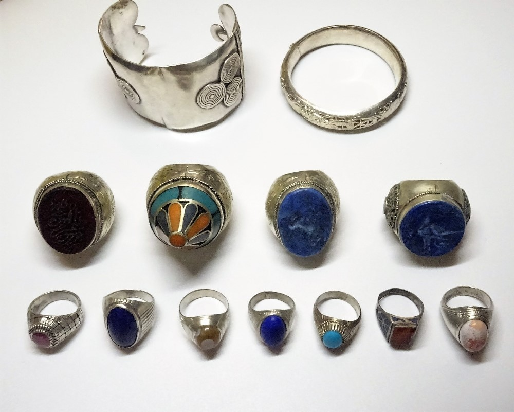 A group of mostly modern Afghan jewellery, comprising; two bangles, four large rings and seven... Image