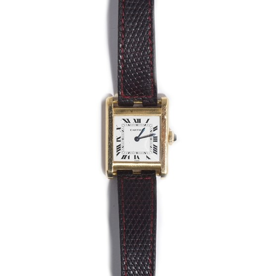 A Cartier Paris 18ct gold rectangular cased tank wristwatch, the signed cream coloured dial with... Image